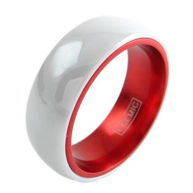 white ceramic ring with red inside